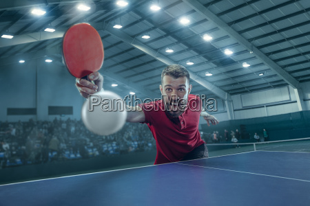 the table tennis player serving