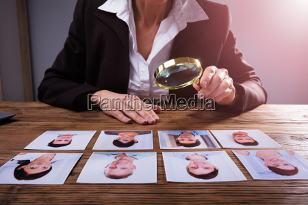 businessperson looking at candidates photograph