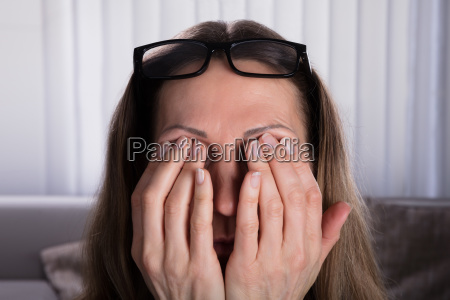 woman covering her eyes with hands