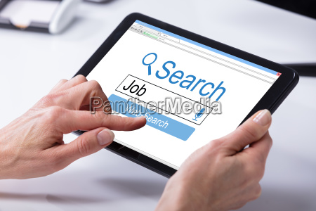 persons hand searching online job