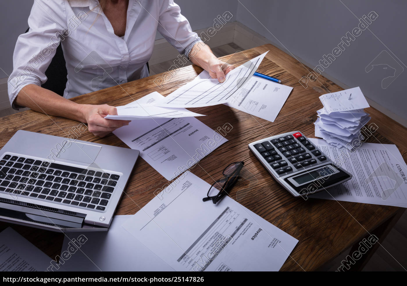 businessperson's, hand, holding, documents - 25147826