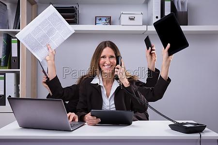 businesswoman, doing, multitasking, work, in, office - 25147834