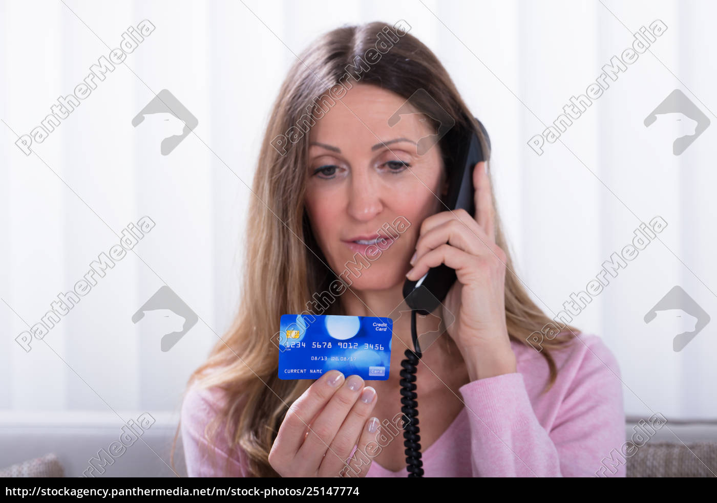 woman, holding, credit, card, while, talking - 25147774