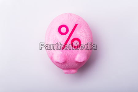 percentage sign on piggy bank