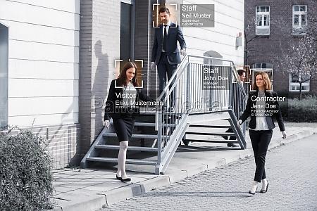 businesspeople walking outside office building