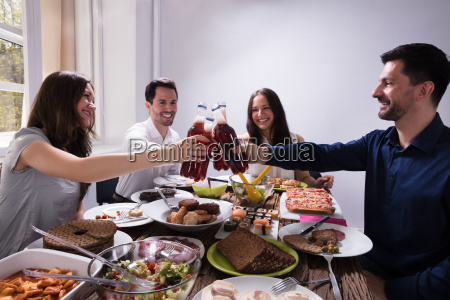 friends, toasting, with, bottles, of, beer - 25155152