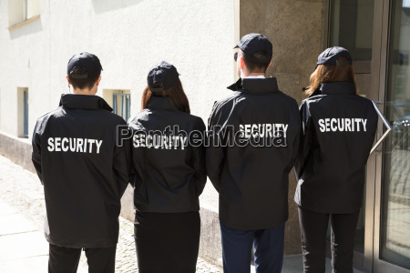 rear, view, of, security, guards, wearing - 25155196