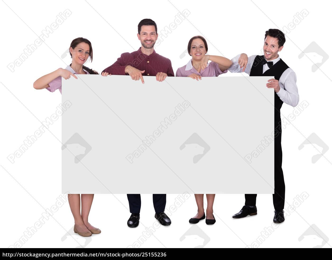 smiling, staff, holding, billboard - 25155236