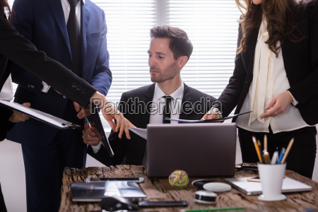 young, businessman, looking, at, document - 25155466