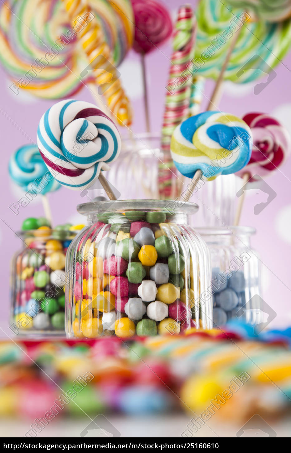 colorful, candies, in, jars, on, table - 25160610