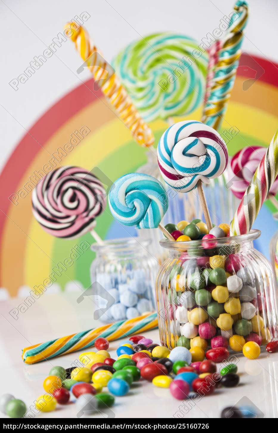 colorful, candies, in, jars, on, table - 25160726