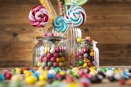 colorful, candies, in, jars, on, table - 25161328