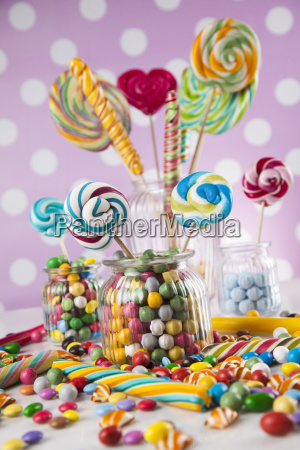 colorful, candies, in, jars, on, table - 25163046