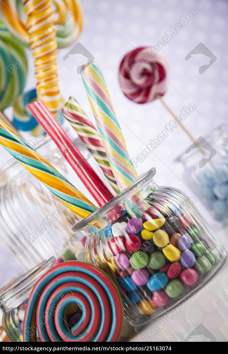 colorful, candies, in, jars, on, table - 25163074