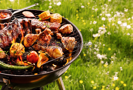 summer barbecue cooking over a hot