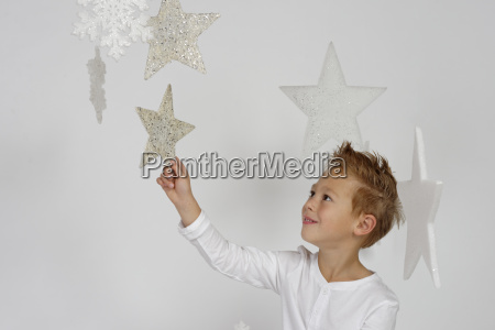 child boy as angel with stars