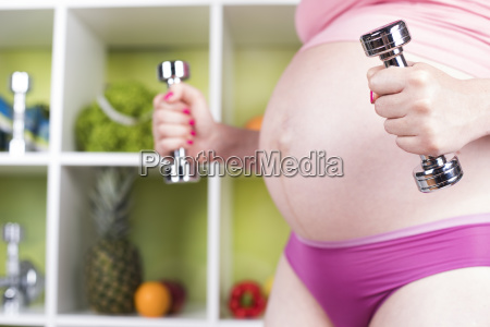 attractive, pregnant, woman, using, a, dumbbell - 25206844