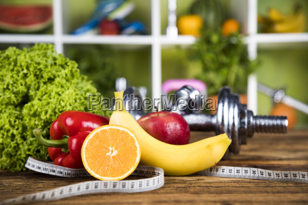 diet and fitness dumbbell with vitamin