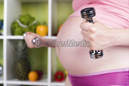 attractive, pregnant, woman, using, a, dumbbell - 25210090