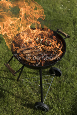 grill with smoke over summer outdoor