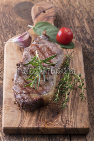 grilled steak on wood with spices