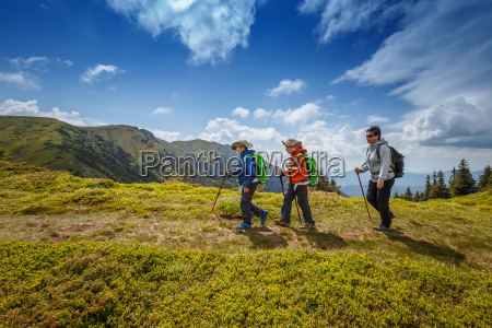 woman with her children hiking