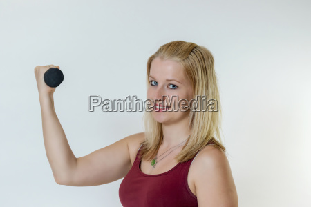 attractive young blond fitness woman working