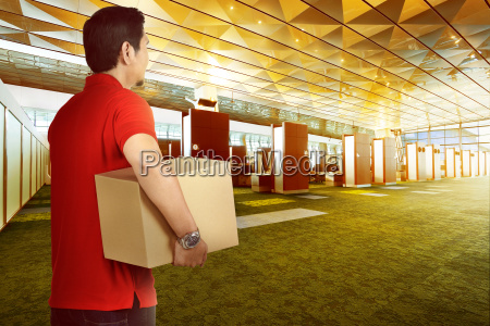 attractive asian delivery man bring package