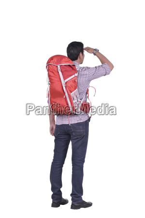 rear view of asian backpacker man