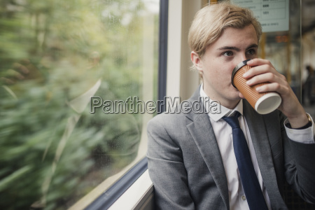businessman, drinking, coffee, on, the, train - 25265542