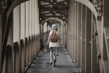 cycling, over, a, bridge, to, work - 25273930