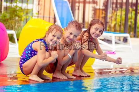 happy kids near the pool