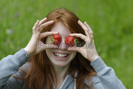 girl teenager with strawberries in front