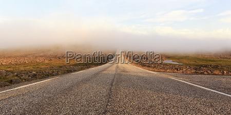 road over a barren plateau midnight