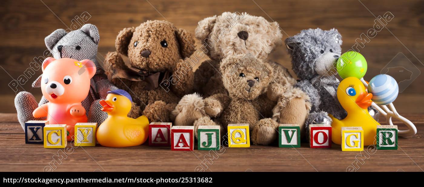 cute, teddy, bears, on, wooden, background - 25313682