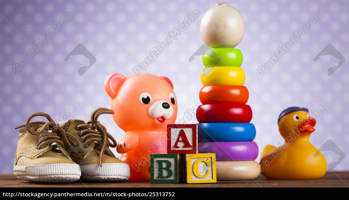 stuffed, baby, toys, on, wooden, background - 25313752