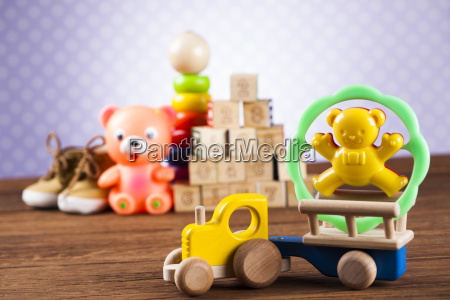 stuffed, baby, toys, on, wooden, background - 25313874
