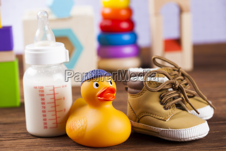 stuffed, baby, toys, on, wooden, background - 25318378