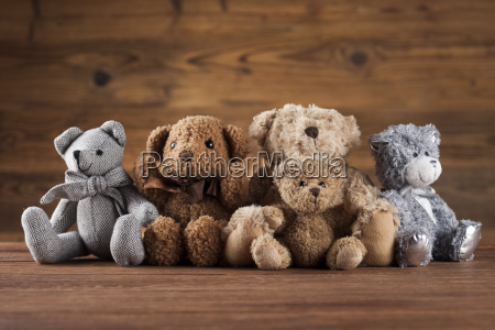 cute, teddy, bears, on, wooden, background - 25319066