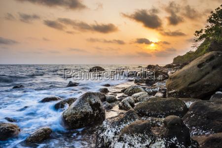 stone asia sunset sights waves long
