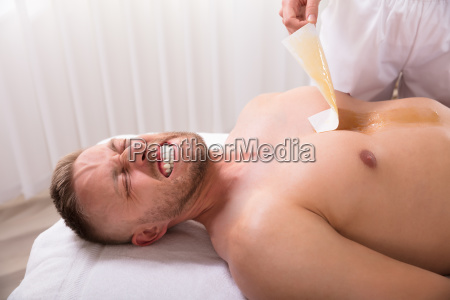 beautician, waxing, man's, chest - 25333434