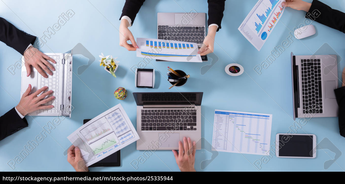 businesspeople, analyzing, graphs - 25335944