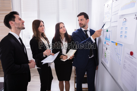 businesspeople, looking, at, charts, attached, on - 25335936