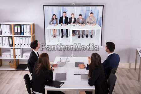 group, of, businesspeople, looking, at, projector - 25335960