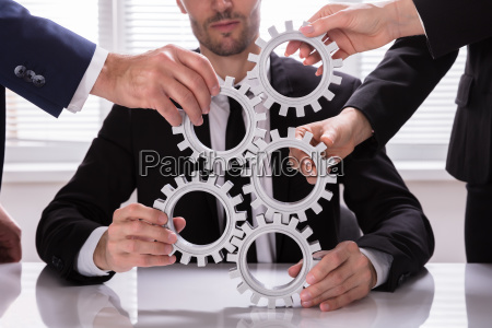 group, of, businesspeople, stacking, gears - 25336136