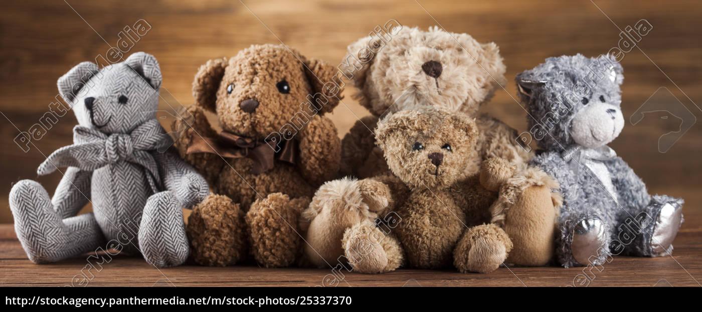 cute, teddy, bears, on, wooden, background - 25337370