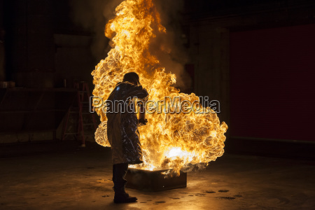 firefighter extinguishes a heptan 2b pan