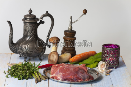 raw lamb meat and vegetables