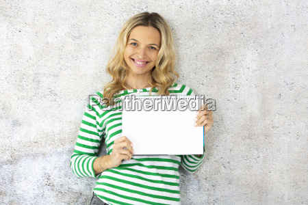 young pretty woman with striped pullover