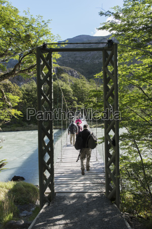 tourists walking on a bridge over